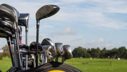 golf clubs in caddy on course